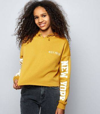 New Look Teens Yellow Brooklyn Print Sleeve Cropped Hoodie (Sizes: 9yrs, 14-15yrs, 10-11yrs)