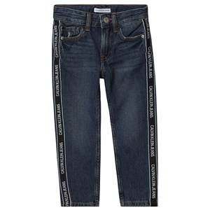 Image of Calvin Klein Jeans Logo Tape Tapered Jeans Mid Wash Denim 14 years