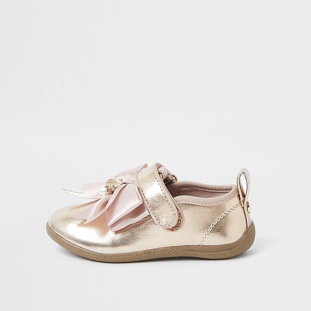 River Island Mini girls rose gold bow shoes