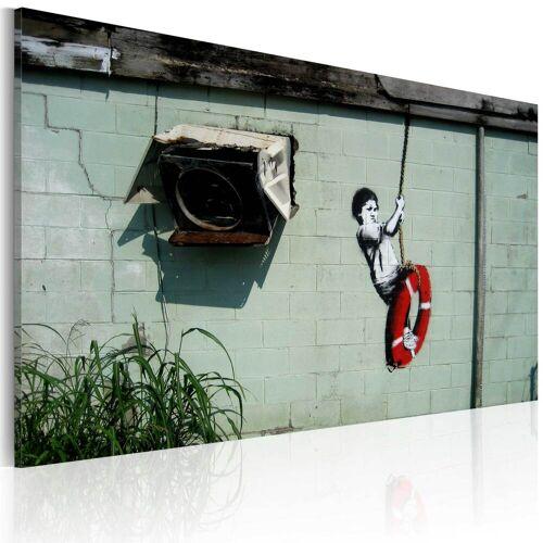 Artgeist Wandbild - Junge auf Schaukel (Banksy)