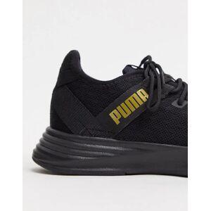 Puma – Radiate XT – Sneaker in Schwarz und Gold 40