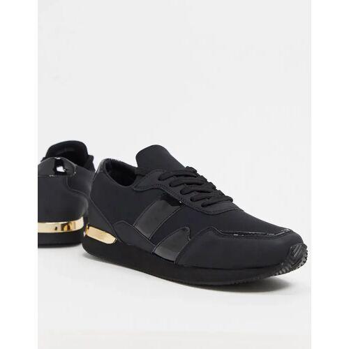 ASOS DESIGN – Sneaker in Schwarz mit goldenen Details 44.5
