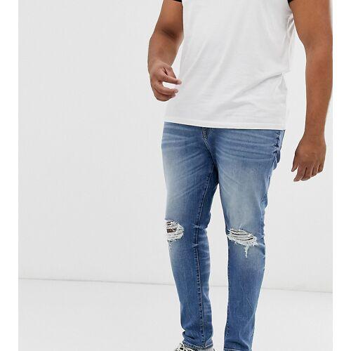 ASOS DESIGN Plus – Superenge Jeans in blauer Waschung mit Abschürfungen am Knie, 12.5 oz W40 L32