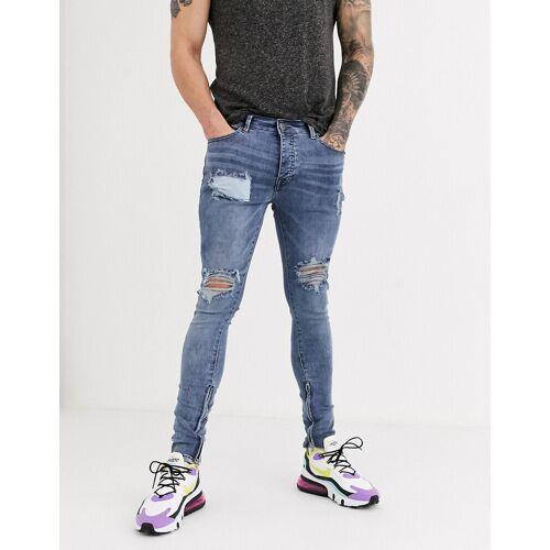 Hermano – Enge Jeans in mittlerer Waschung mit Abschürfungen-Blau W34 L32