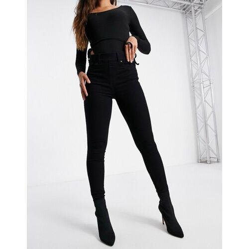 Spanx – Eng geschnittene Jeans in Schwarz L