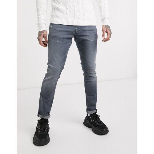 G-Star – Enge Jeans mit Abnutzungseffekt in Grau W33 L34