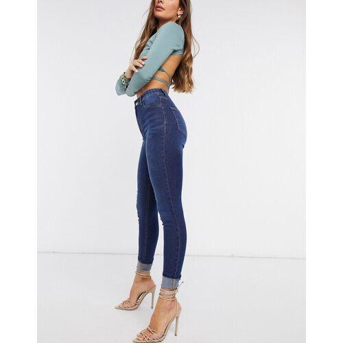 NA-KD – Enge Jeans mit Tasche in Dunkelblau 34