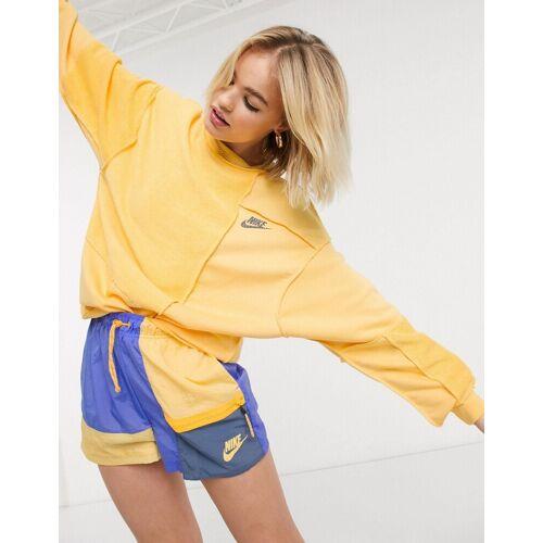 Nike – Sweatshirt mit umgekehrtem Einsatz in Gelb XL