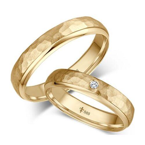 Hochzeitsringe mit Hammerschlag aus Gelbgold mit einem Brillanten