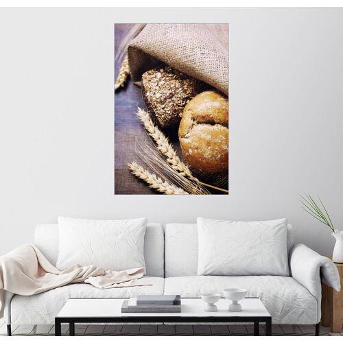 Posterlounge Wandbild, Leinwandbild Frisch gebackenes Brot auf Holztisch