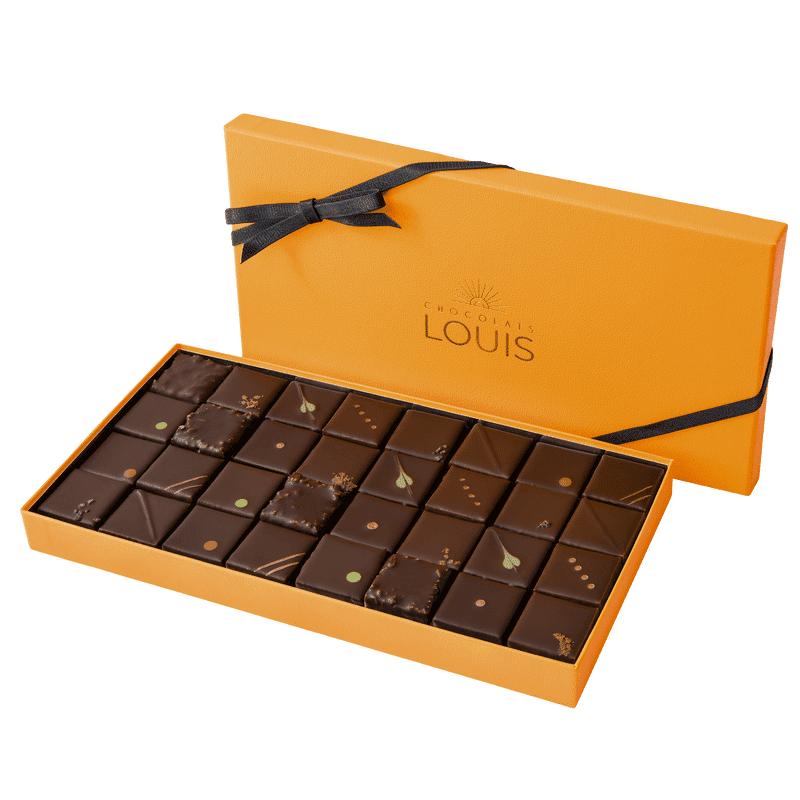 Interflora Assortiment de ganaches et pralinés chocolat noir X 32 - Chocolats Louis - Livraison par Chronopost - L'atelier Interflora - Interflora