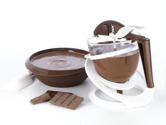 . Doseur à chocolat avec piston
