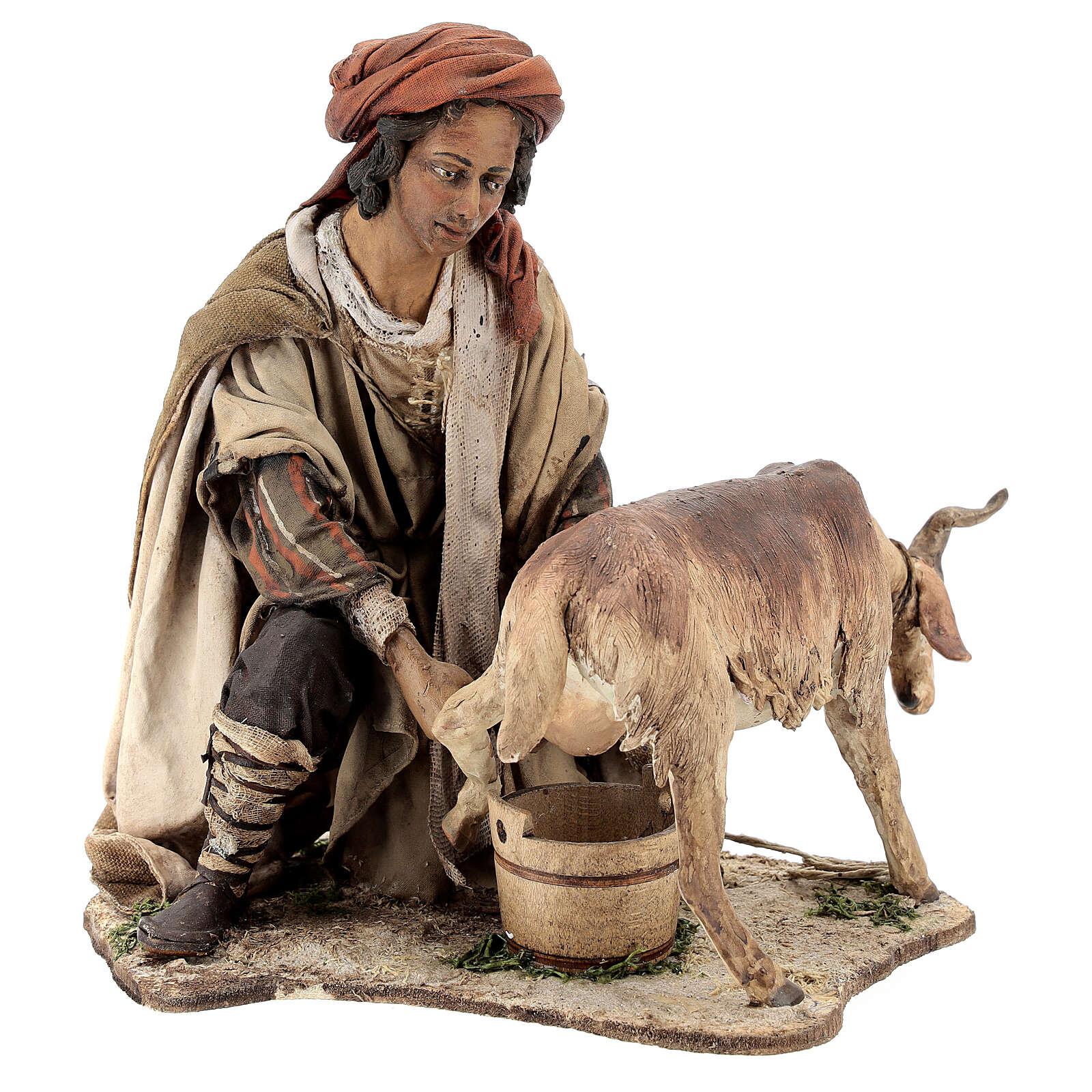 Paysan qui trait une chèvre 30 cm crèche Angela Tripi