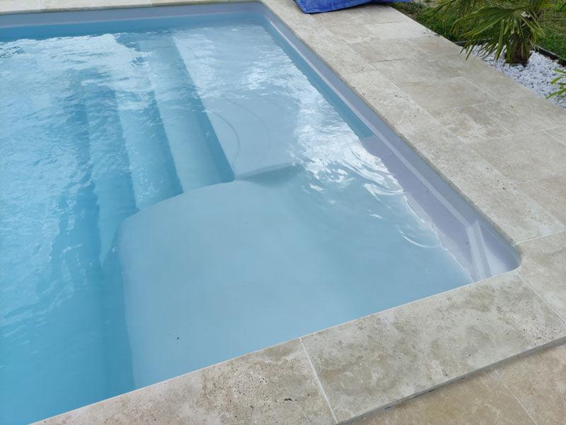 Margelle piscine travertin beige mixte 1er : bassin de 4.00 x 2.50 m