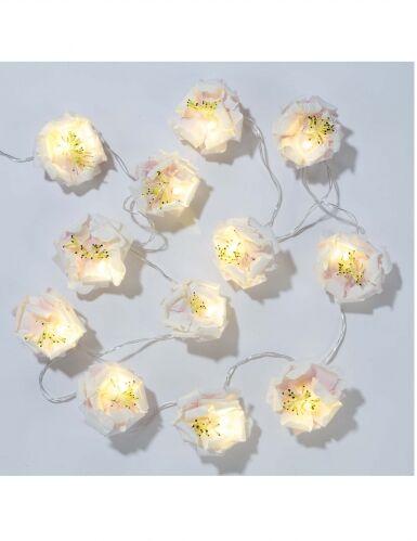 Ghirlanda luminosa con fiori bianchi