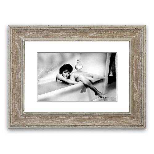 East Urban Home 'Joan Collins in The Tube' Framed Photographic Print East Urban Home Size: 93 cm H x 126 cm W, Frame Options: Walnut  - Size: 50 cm H x 70 cm W