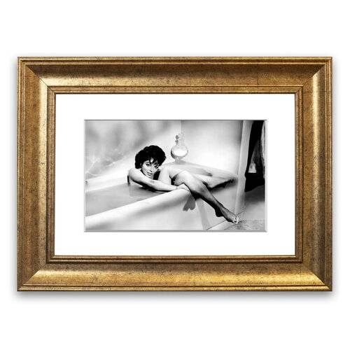 East Urban Home 'Joan Collins in The Tube' Framed Photographic Print East Urban Home Size: 93 cm H x 126 cm W, Frame Options: Gold  - Size: 50 cm H x 70 cm W