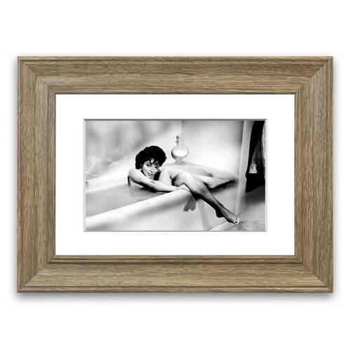 East Urban Home 'Joan Collins in The Tube' Framed Photographic Print East Urban Home Size: 93 cm H x 126 cm W, Frame Options: Teak  - Size: 50 cm H x 70 cm W