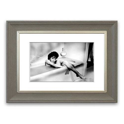 East Urban Home 'Joan Collins in The Tube' Framed Photographic Print East Urban Home Size: 93 cm H x 126 cm W, Frame Options: Grey  - Size: 50 cm H x 70 cm W