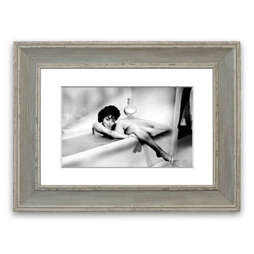 East Urban Home 'Joan Collins in The Tube' Framed Photographic Print East Urban Home Size: 93 cm H x 126 cm W, Frame Options: Blue  - Size: 93 cm H x 70 cm W