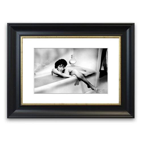 East Urban Home 'Joan Collins in The Tube' Framed Photographic Print East Urban Home Size: 93 cm H x 70 cm W, Frame Options: Matte Black  - Size: 50 cm H x 70 cm W