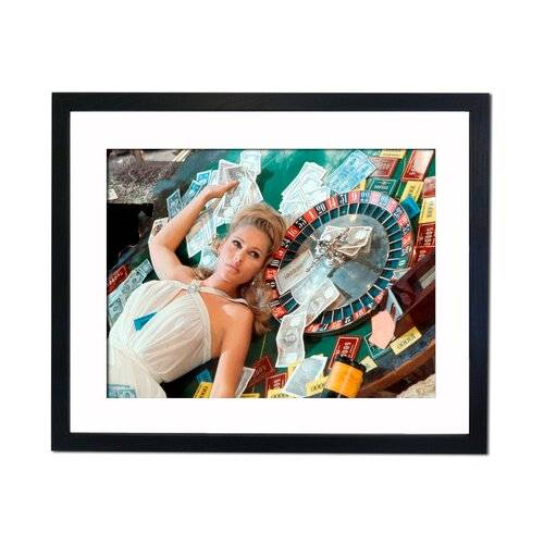 East Urban Home Ursula Andress - Casino Royal Framed Photographic Print East Urban Home  - Size: Mini (Under 40cm High)