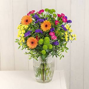 Serenata Flowers Vibrant Sorbet Bouquet: Yellow Lilly, Orange Germini, Cerise Carnations and Yellow Santini. Next day online flower delivery.
