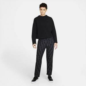 Nike Women's Sportswear Tech Pack Printed Woven Pants in Black/Black Size Medium Cotton/Polyester/Fleece