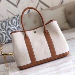 DHgate 75% off luxury handbag 2021 new canvas garden women's one shoulder slant cross portable fashion shopping bag bucket tote bag 2kek