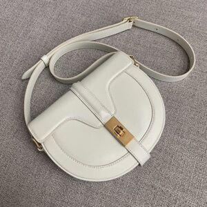 DHgate 75% off luxury handbag new leather shoulder messenger bag minority semicircle women's fashionable saddle bag 07l2