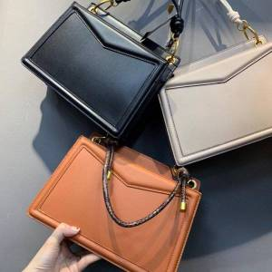 DHgate pineapple brand bag shoulder pw2-75210073 women's metal ring decorative handbag armpit clutch bags