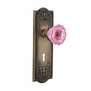 Nostalgic Warehouse Meadows Plate with Keyhole 2-3/8 in. Backset Antique Brass Privacy Bed/Bath Crystal Pink Glass Door Knob