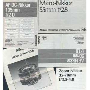 Nikon Camera manuals for the Zoom-Nikkor 35-70mm f/3.5-4.8, the Nikkor 20mm f/3.5, the AF DC-Nikkor 135mm f/2 D, the Micro-Nikkor 55mm f/3.5, and the