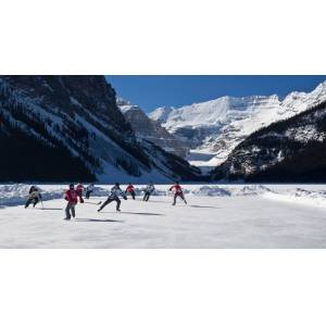 Panoramic Images PPI166939LARGE Hockey Players Playing On The Frozen Lake Louise Mount Victoria Banff National Park Alberta Canada Poster Print, 12 x 24 - Large